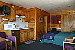 Sample bedroom with pine paneling
